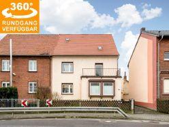 Gepflegtes Zweifamilienhaus (155 m² Wfl., 684 m² Grundstück) in zentraler Lage von Mittelbuchen